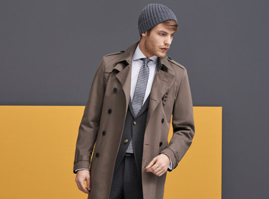 Brown trenchcoat with dark grey suit, white shirt, grey tie and grey cap by BOSS