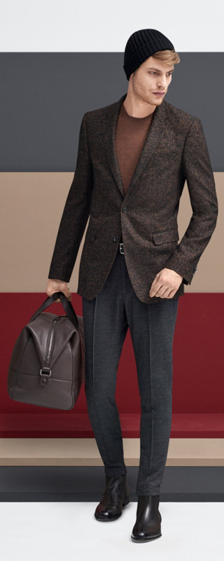 Bown suit over brown knitwear with a black hat, a grey bag and black shoes by BOSS