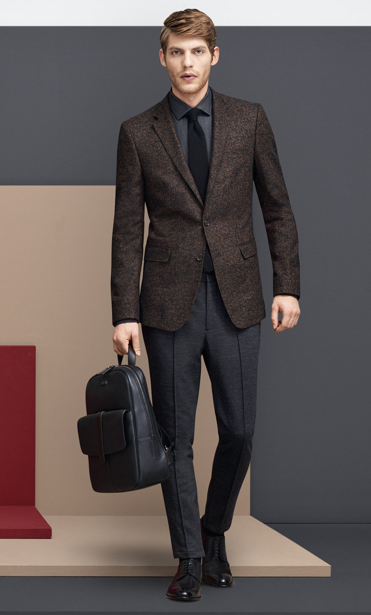 Brown Coat over black shirt, a black bag and black shoes by BOSS