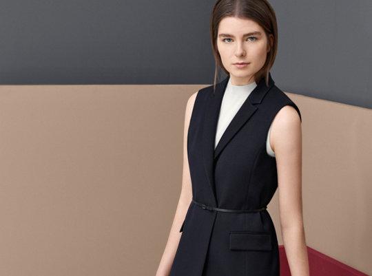Black vest, beige knitwear and black trousers by BOSS