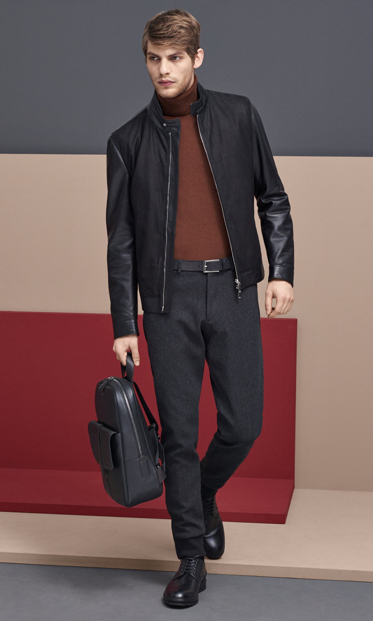 Black Leather jacket over brown knitwear and black trousers by BOSS