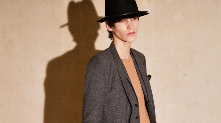 Grey suit, brown knitwear and black hat by HUGO