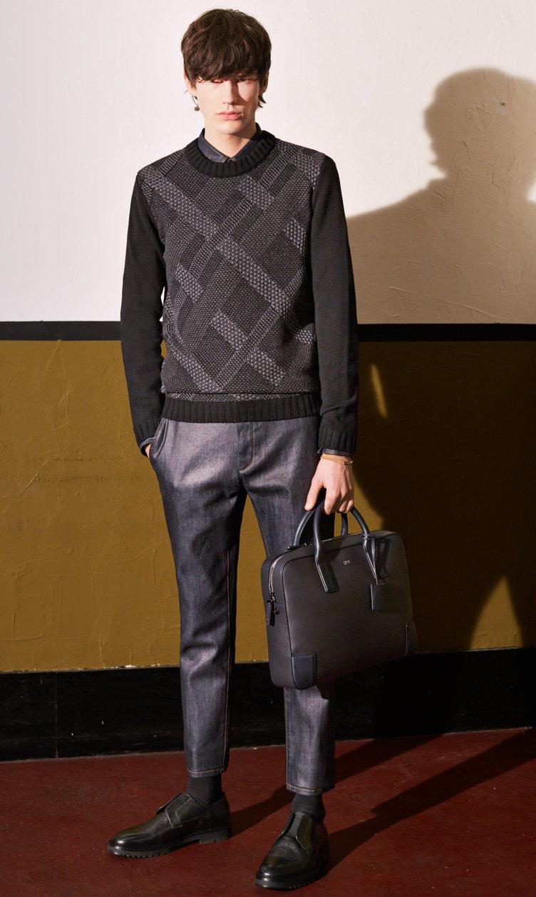 Black sweater, dark blue trousers