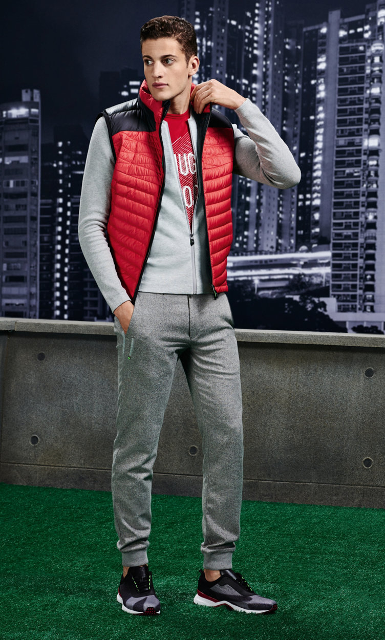 Red waistcoat, grey knit jacket, red t-shirt, trousers, belts and shoes by BOSS Green