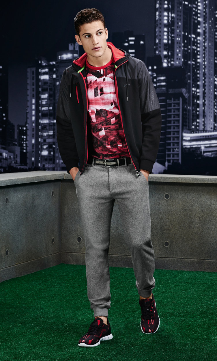 Black Jersey jacket, patterned sweatshirt, grey trousers, belt and shoes by BOSS Green