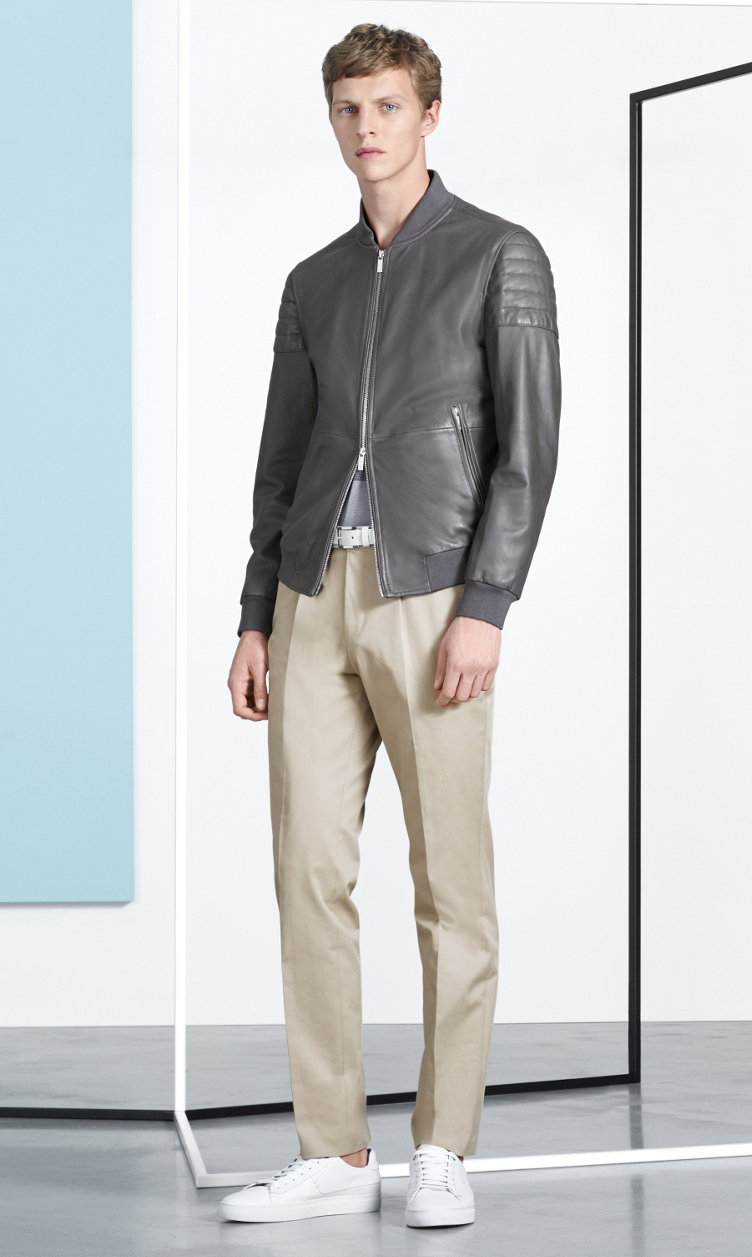 Leather jacket, jersey, beige trousers and white shoes by BOSS