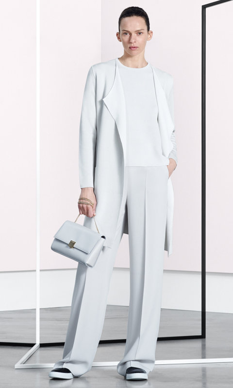 White coat, knitwear, trousers, pastel grey bespoke bag and black shoes by BOSS