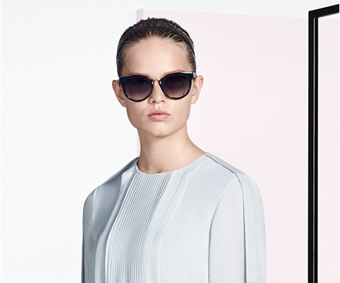 White dress and sunglasses by BOSS