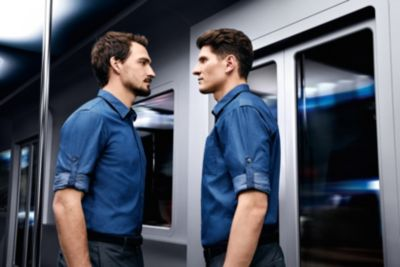 Mats Hummels and Mario Gomez wearing a blue shirt and pants by BOSS