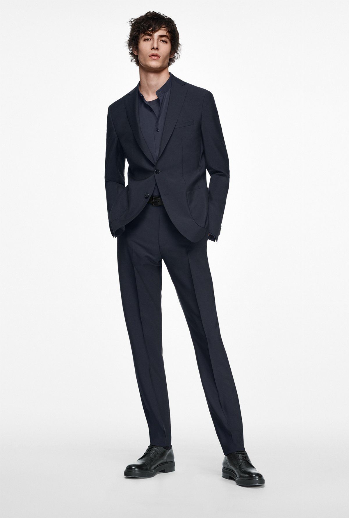 Man Wearing A Dark Blue Suit For City Wedding Occasion By Boss