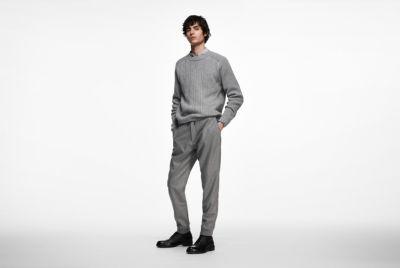 Male model wearing cosy knitwear by BOSS