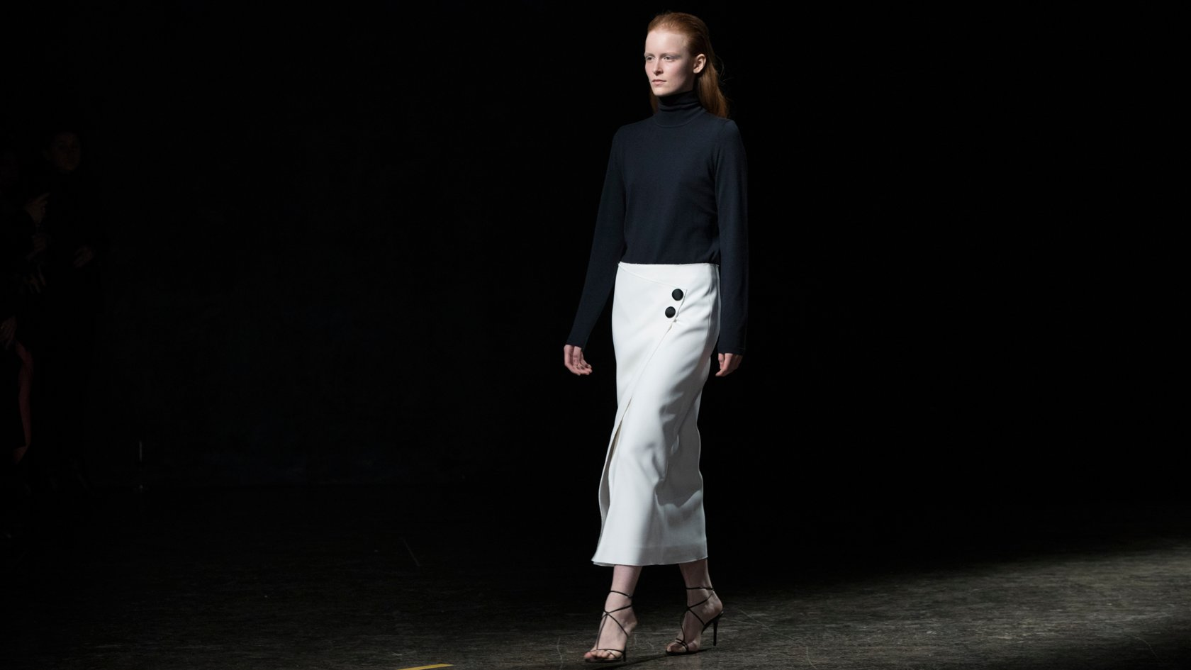 a3f557fc85c2 Woman wearing a white skirt styled with a black knitwear turtleneck from  the BOSS Womenswear Gallery ...
