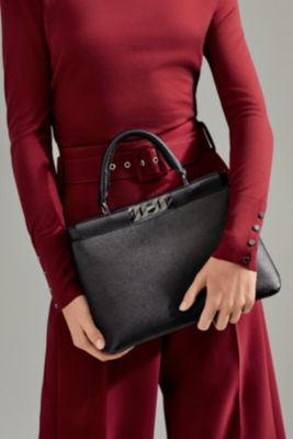 Female model wearing a bag from BOSS