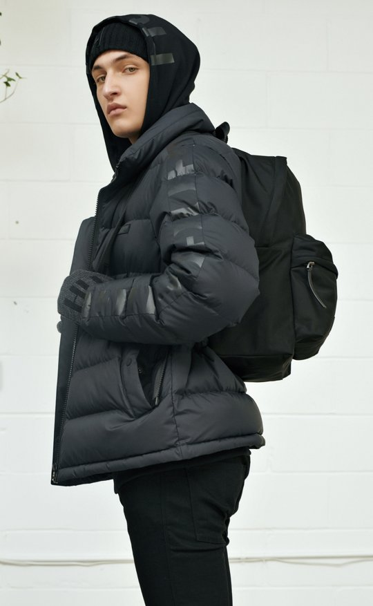 Anwar Hadid wearing a down jacket with HUGO Logo print ... ebb6f59be8f