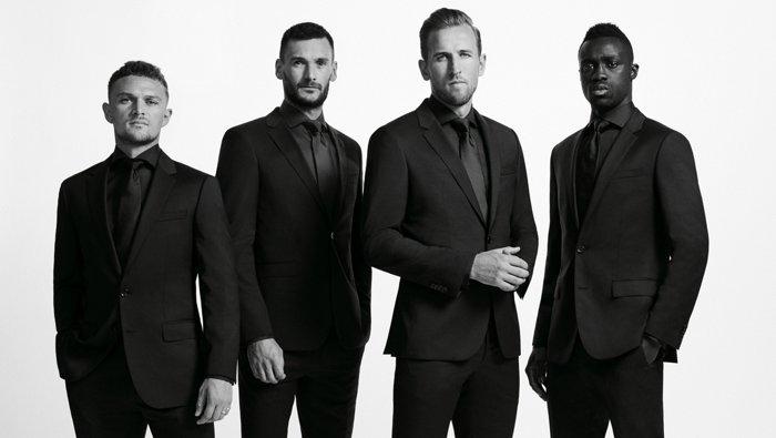 Jugadores del Tottenham Hotspur con trajesBOSS