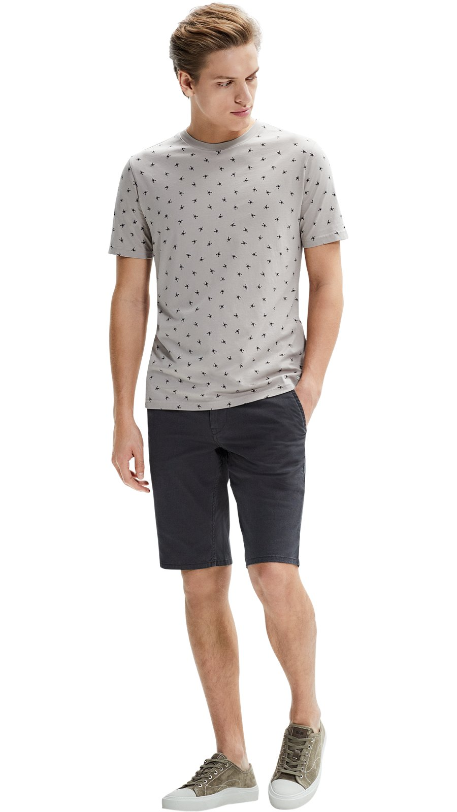26801ee7 Man wearing a light beige t-shirt, black trousers and dark blue shoes by ...