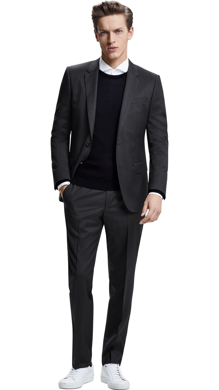 a747400443334e Man weaing a mix and match dark grey suit together with black knitwear, ...