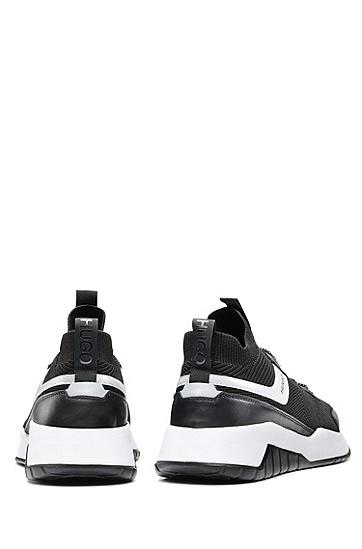 针织鞋面搭配皮革的运动鞋,  001_黑色