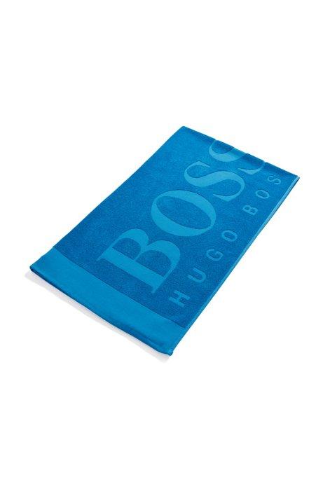 Serviette de plage à logo en jacquard de coton doux, Bleu