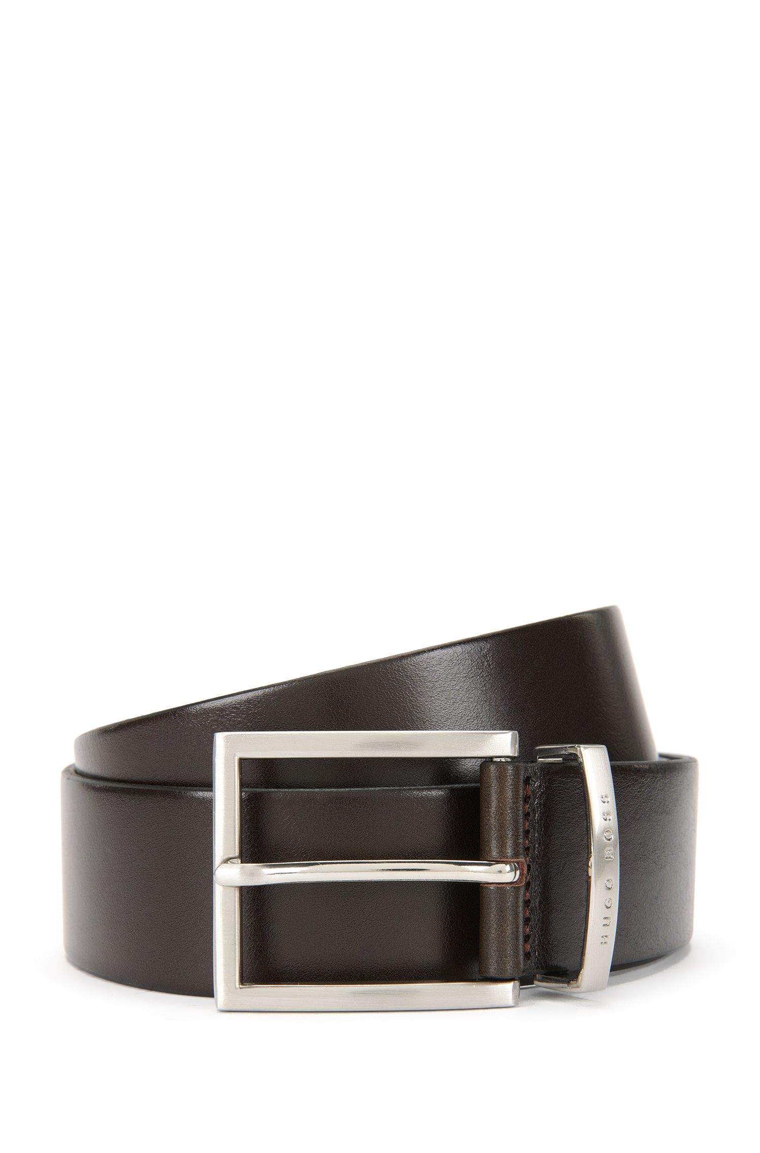Leather belt with silver pin buckle