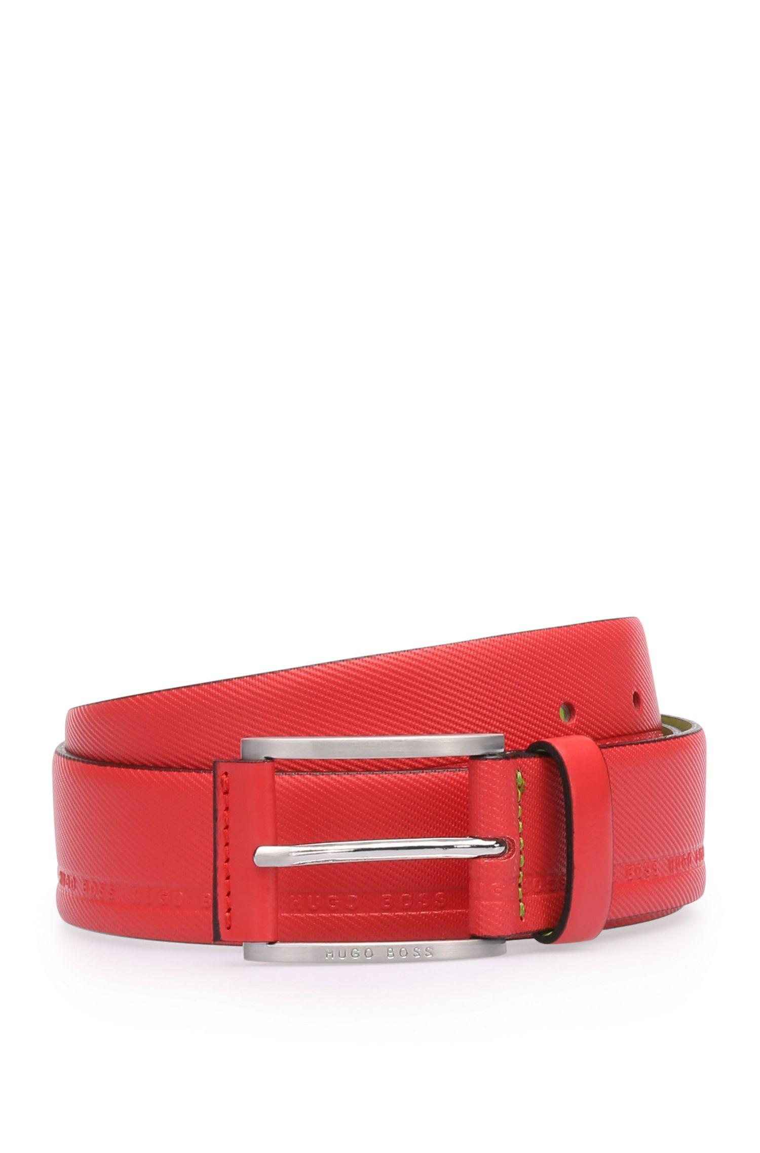 Cintura in pelle dalla lavorazione vistosa con logo stampato: 'Tymos'