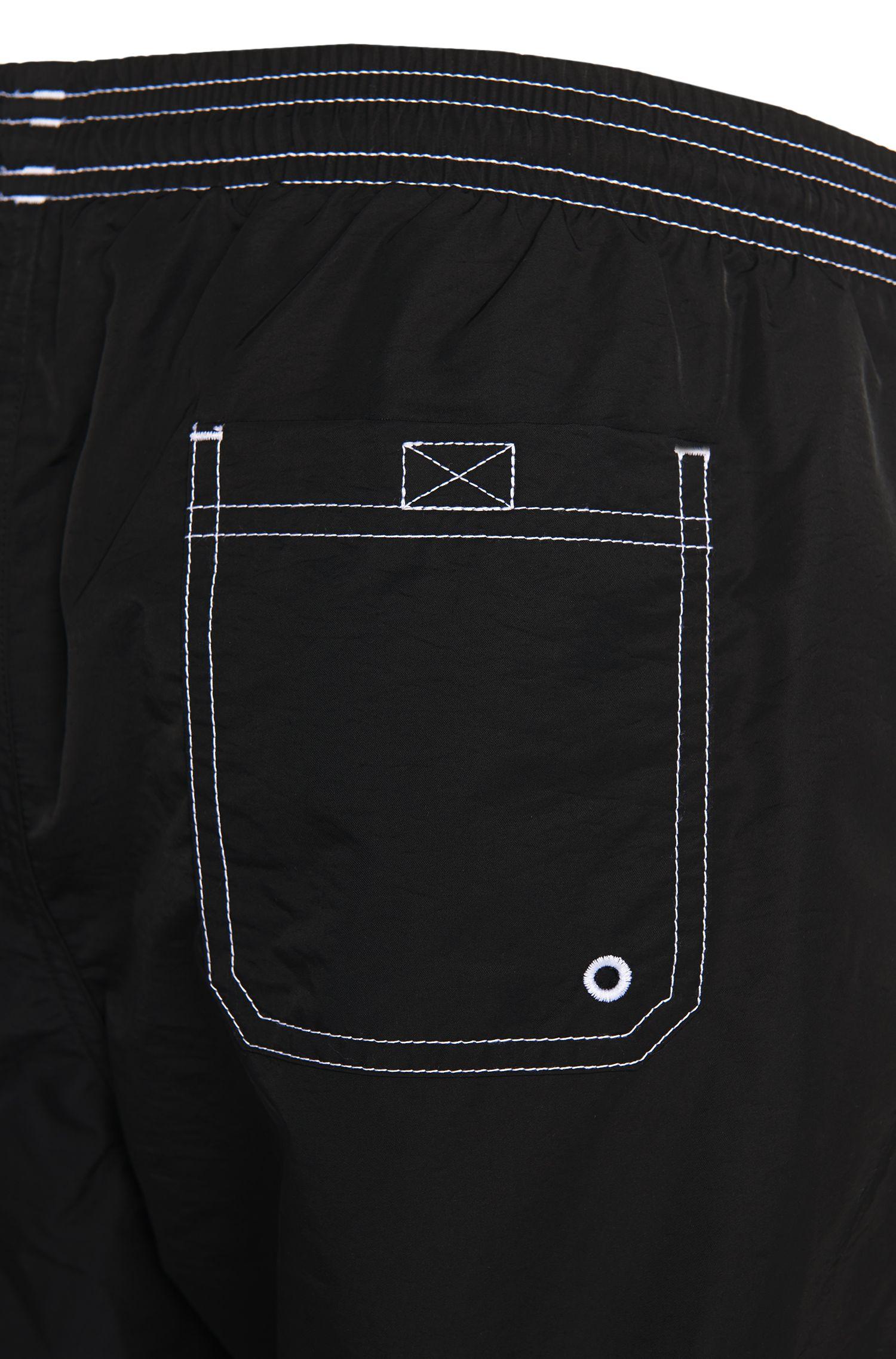 Badeshorts aus Funktionsgewebe mit Logo-Print, Schwarz