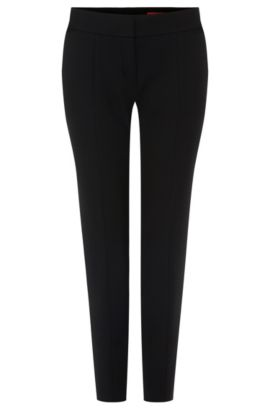 Slim-fit trousers in a stretchy material blend with viscose and cotton: 'Hevas', Black