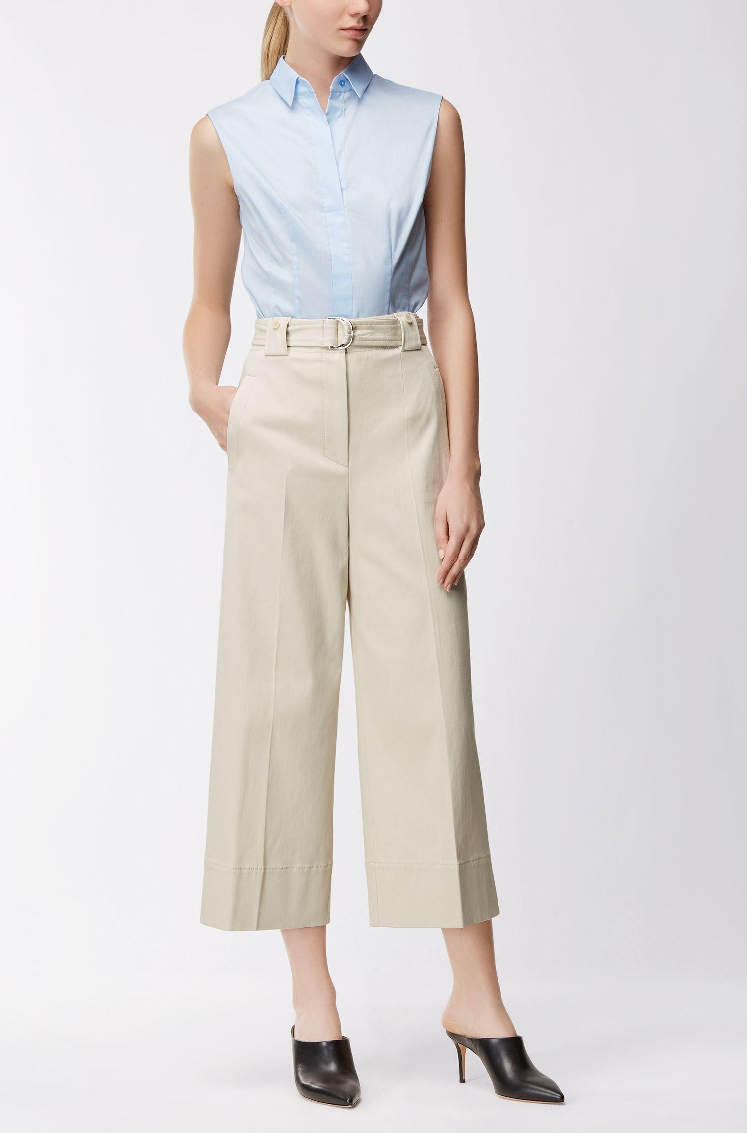 Blusa slim fit sin mangas en mezcla de algodón