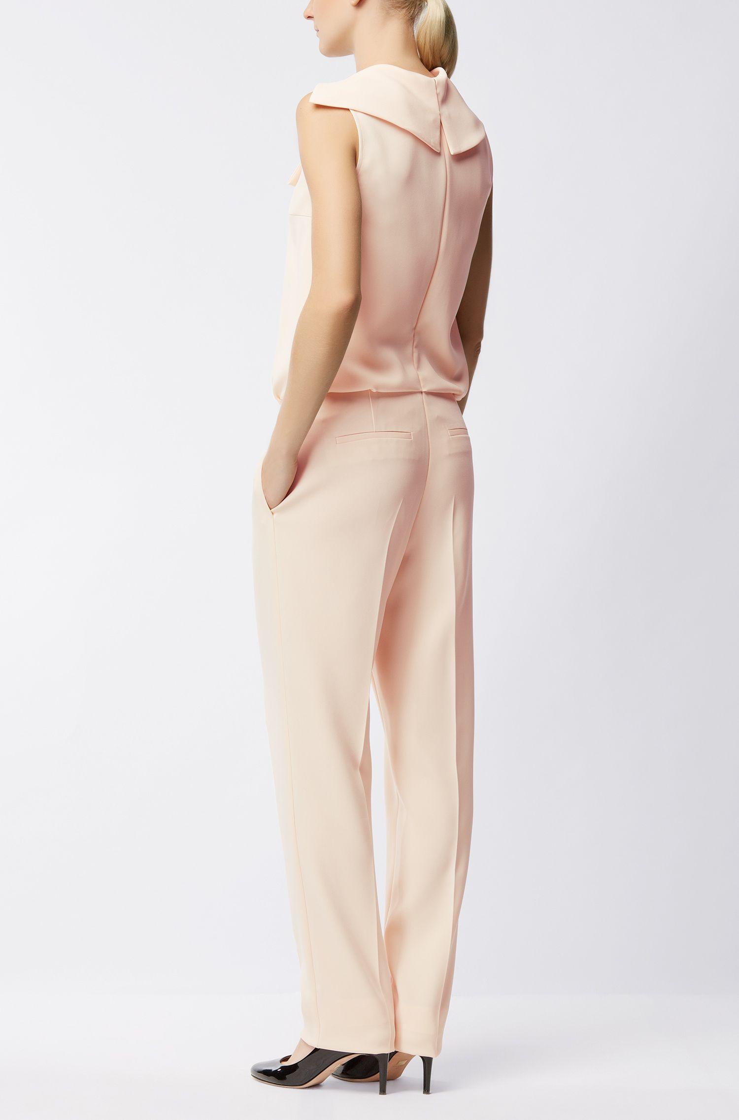 Sleeveless jumpsuit with asymmetric neckline