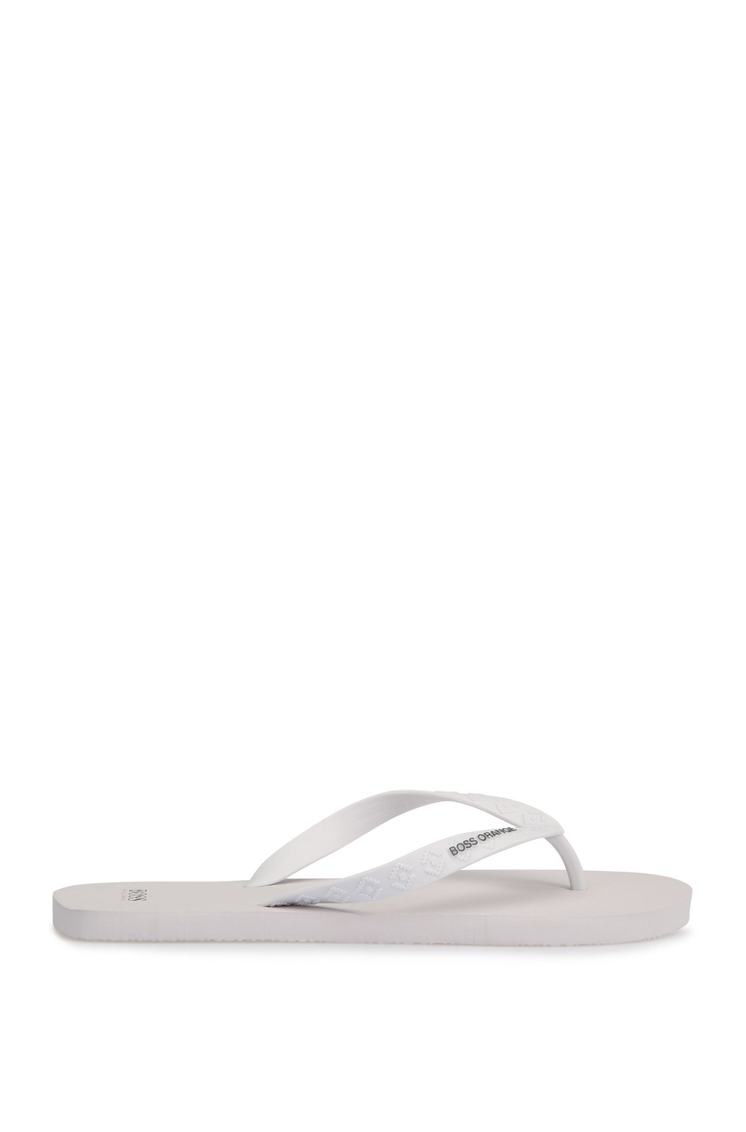 Toe-separator sandals with embossed-logo straps: 'Loy'