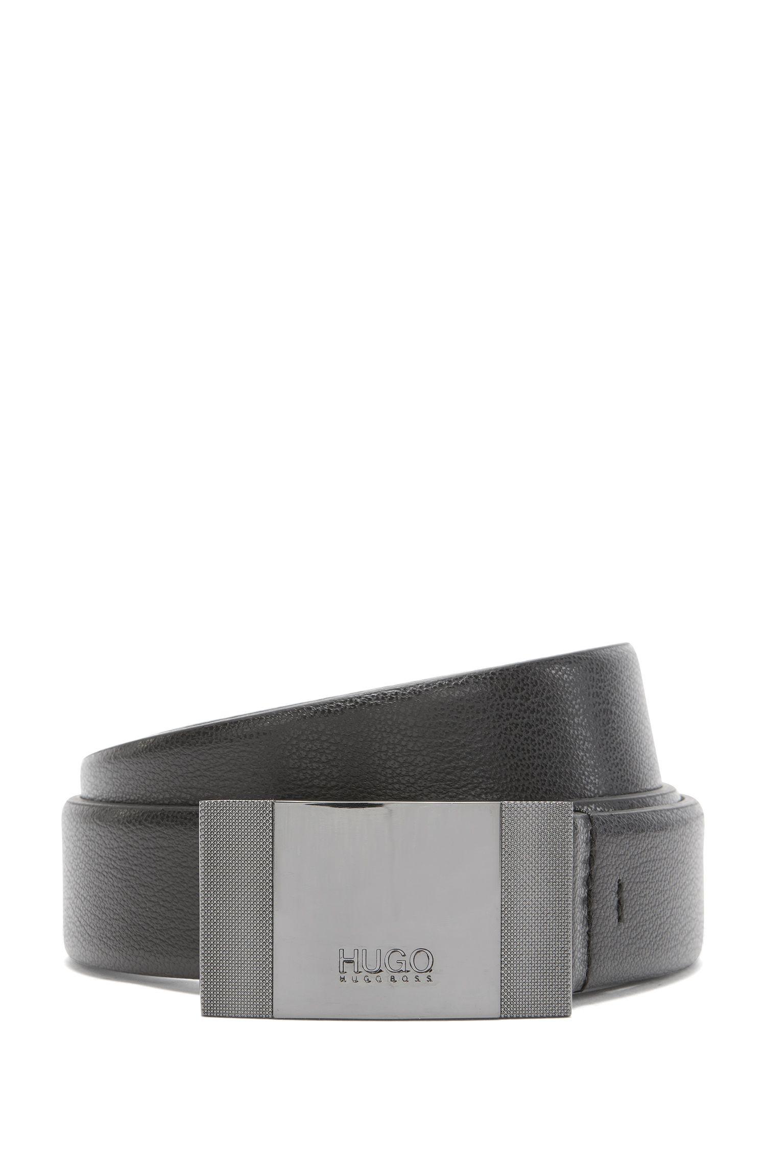 Ledergürtel mit Logo-Gravur auf der Koppelschließe