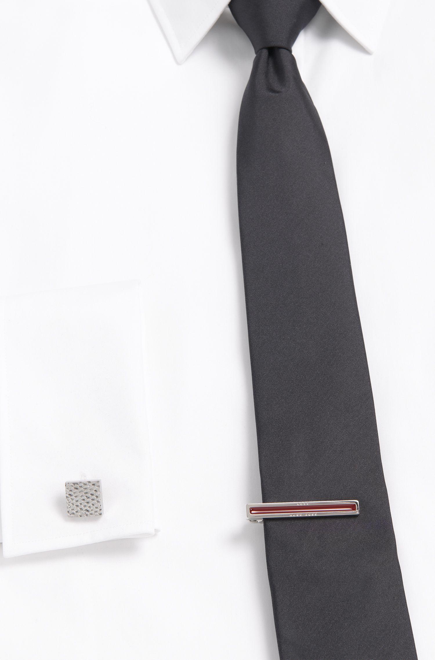 Tie clip with enamel core
