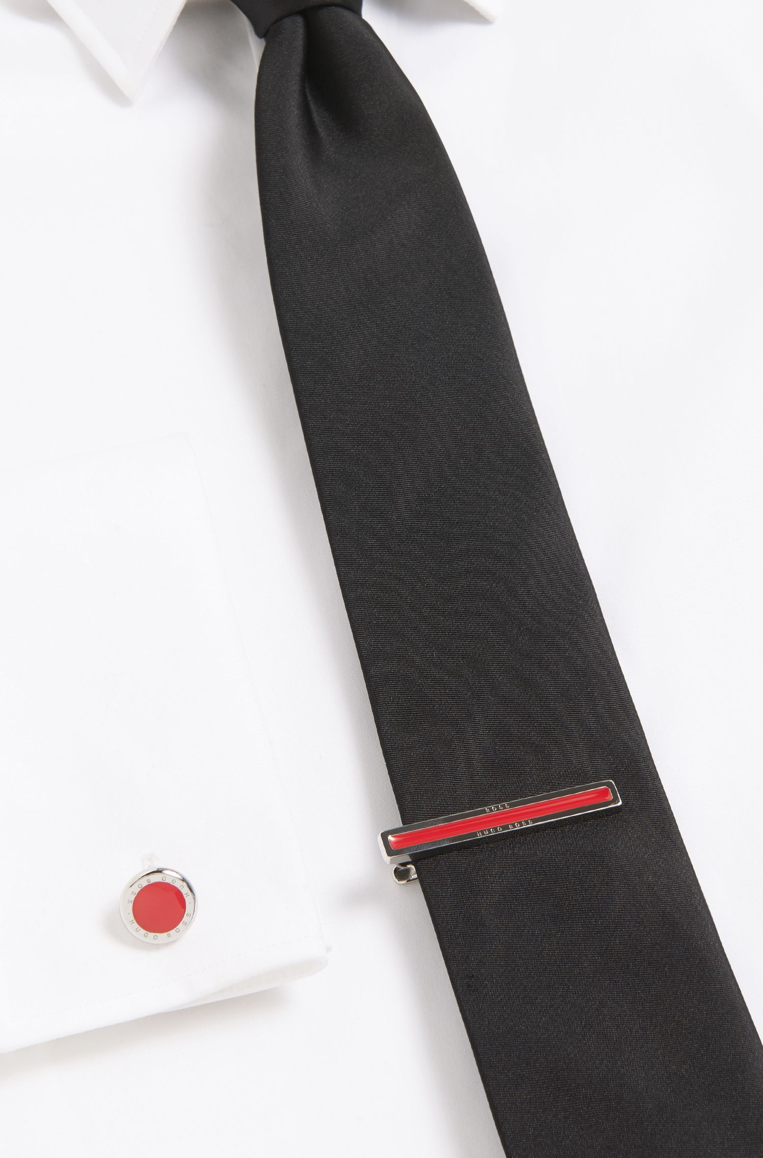 Tie clip with enamel core