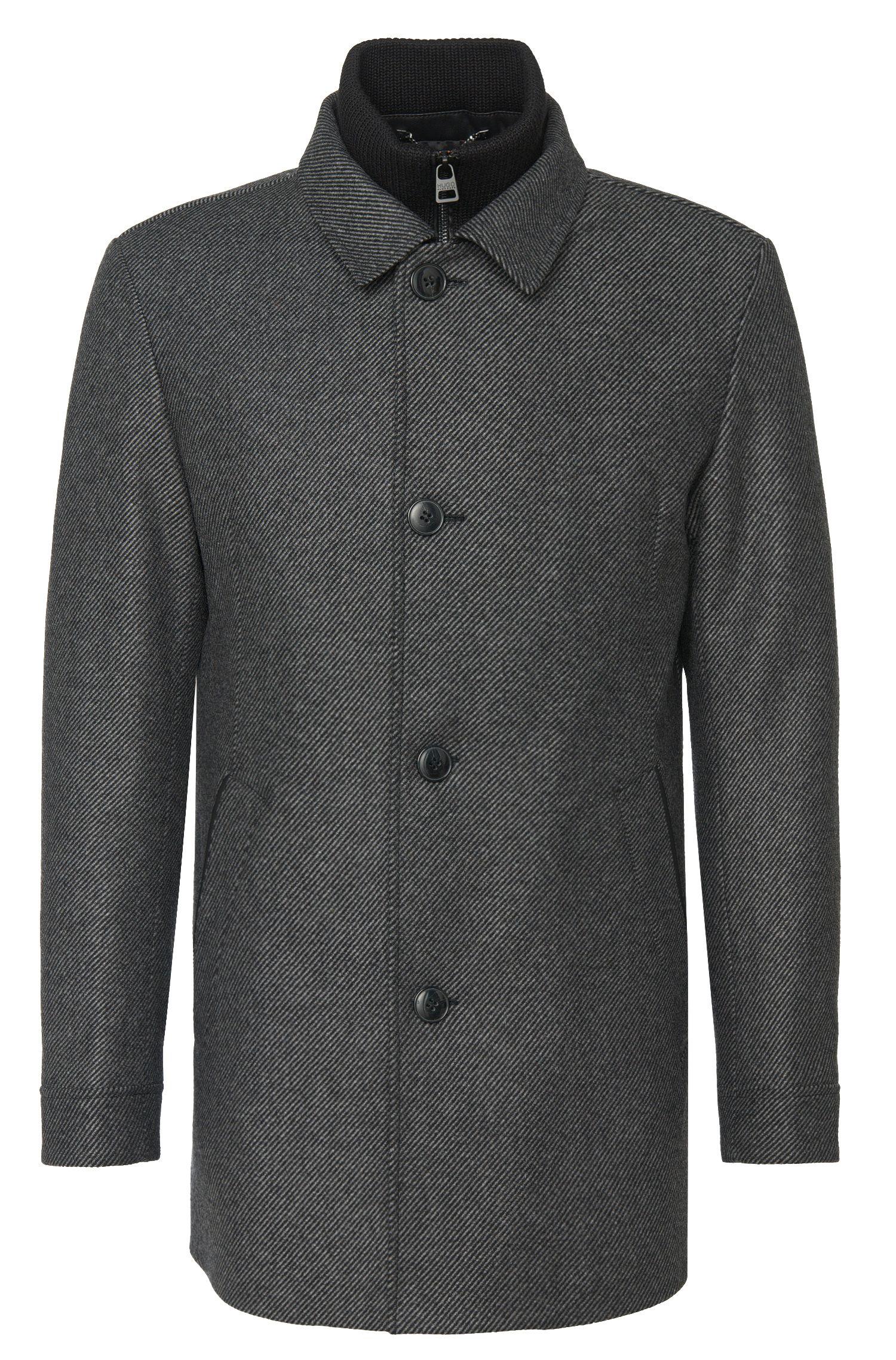 Gestreepte jas van een materiaalmix met rits- en knoopsluiting: 'Barelto':