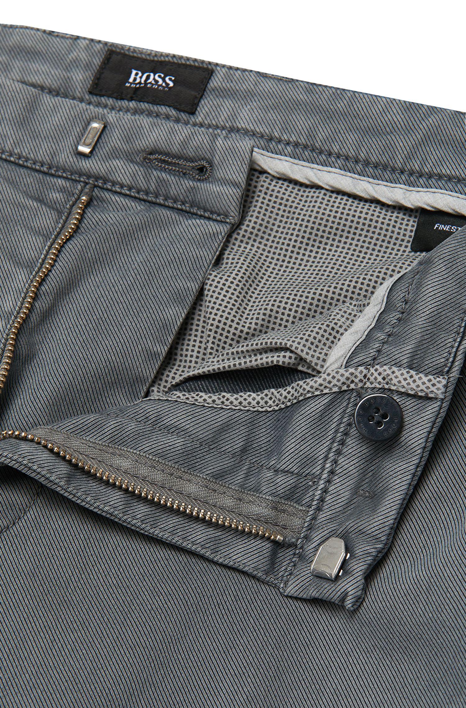 Chinos slim fit en sarga de algodón elástico italiano