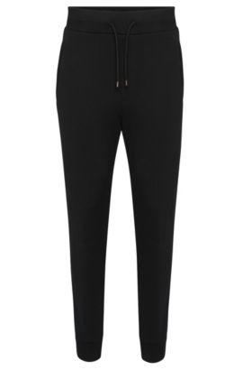 Pantalon sweat Regular Fit en coton orné de détails à effet cuir: «Drontier», Noir