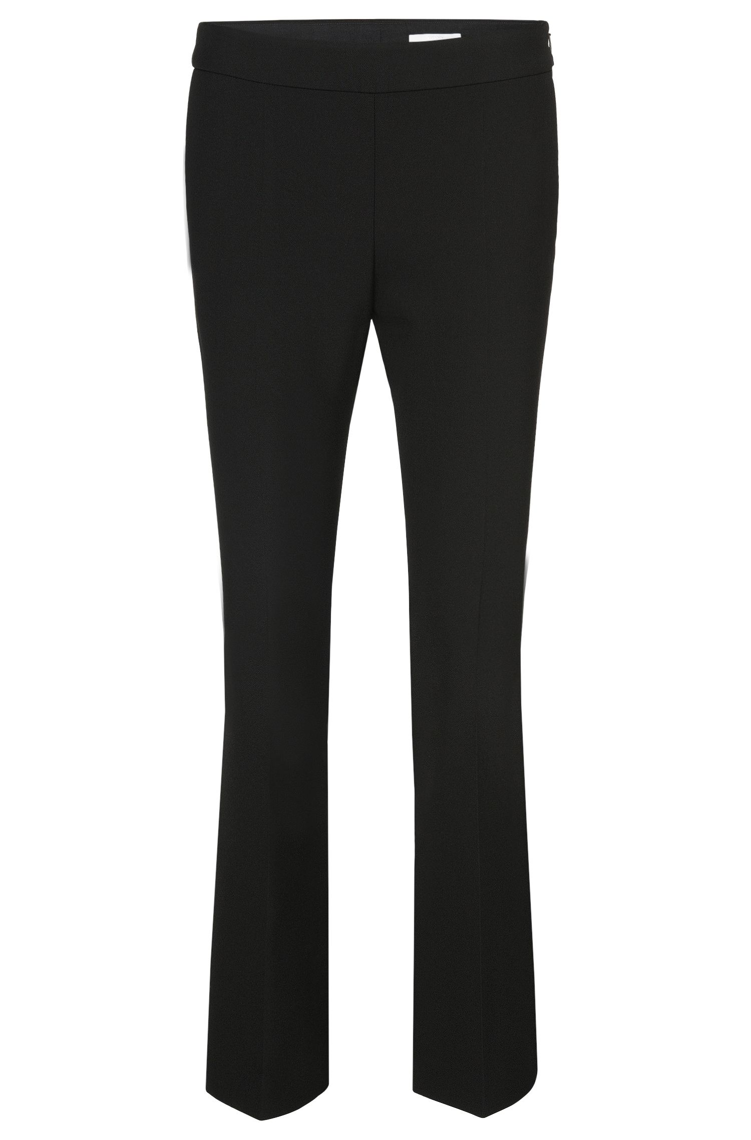 Slim-fit trousers with a flared leg: 'Tutina1'