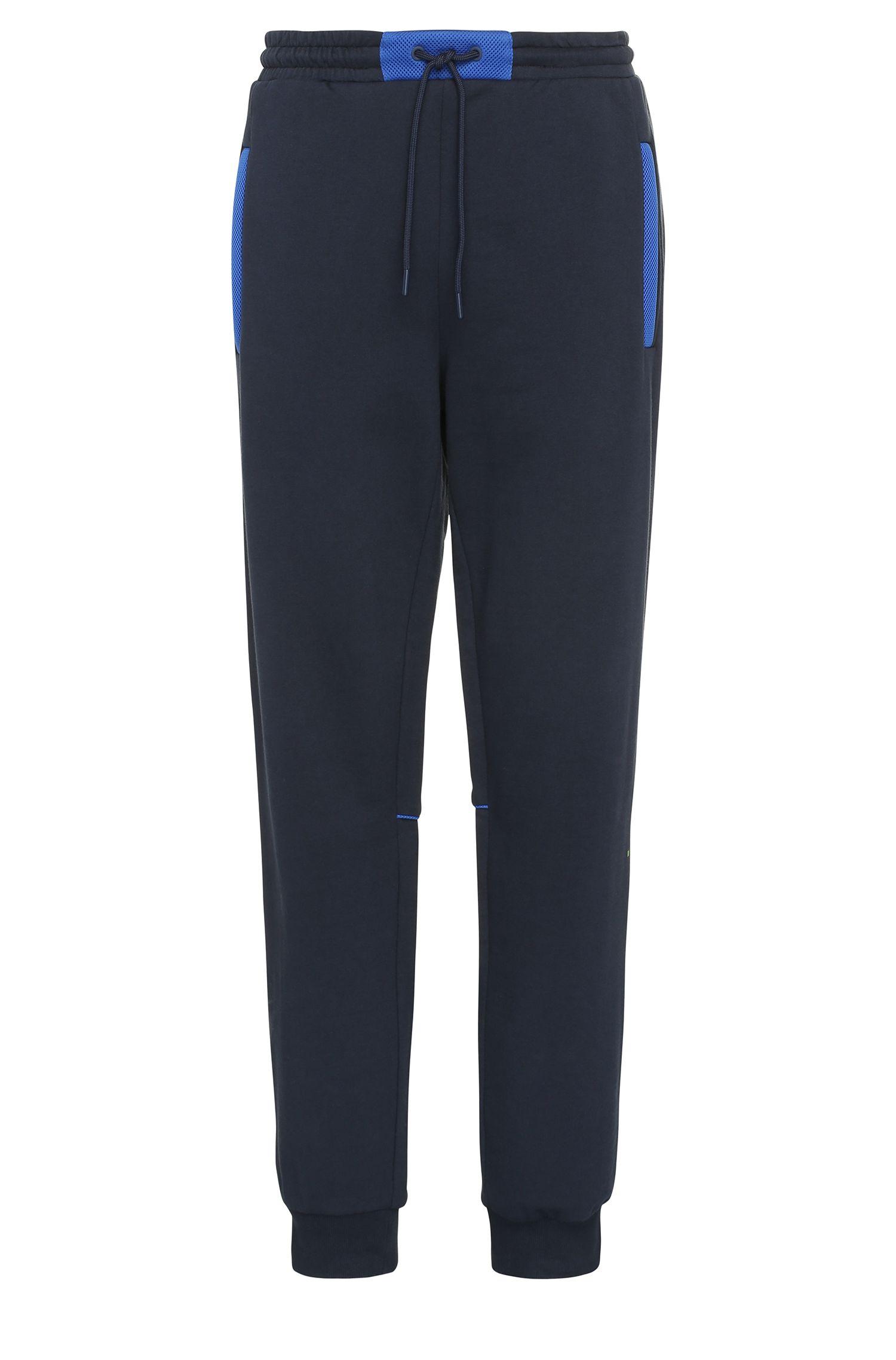 Pantalón de chándal relaxed fit en algodón con ribetes contrastados: 'Harid'
