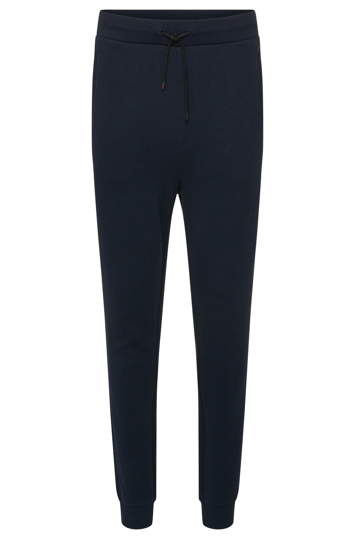 Regular-fit tracksuit bottoms in cotton with textured sections: 'Dratosphere'