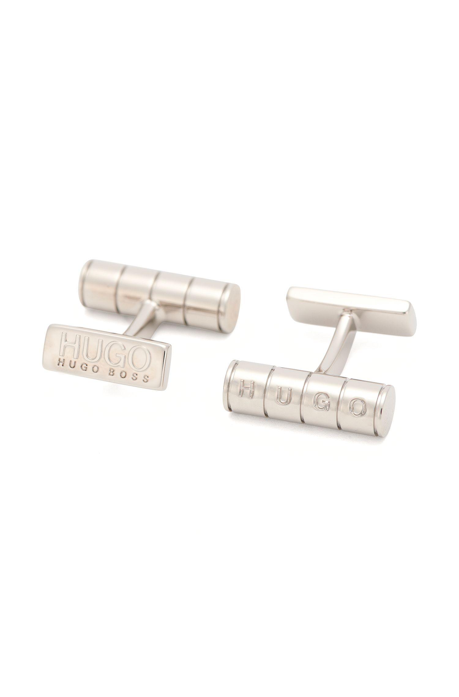 Gemelos de latón con logo grabado: 'E-SLOT'