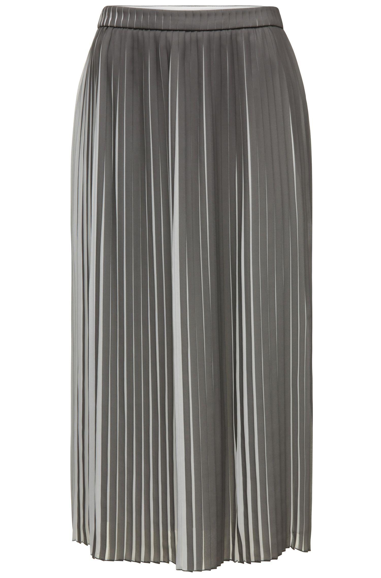 Tweekleurige plissérok van een materiaalmix in midilengte: 'Baplissa'