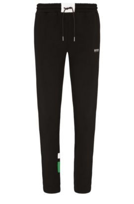 Regular-fit tracksuit bottoms in a stretch cotton blend: 'Halko', Black