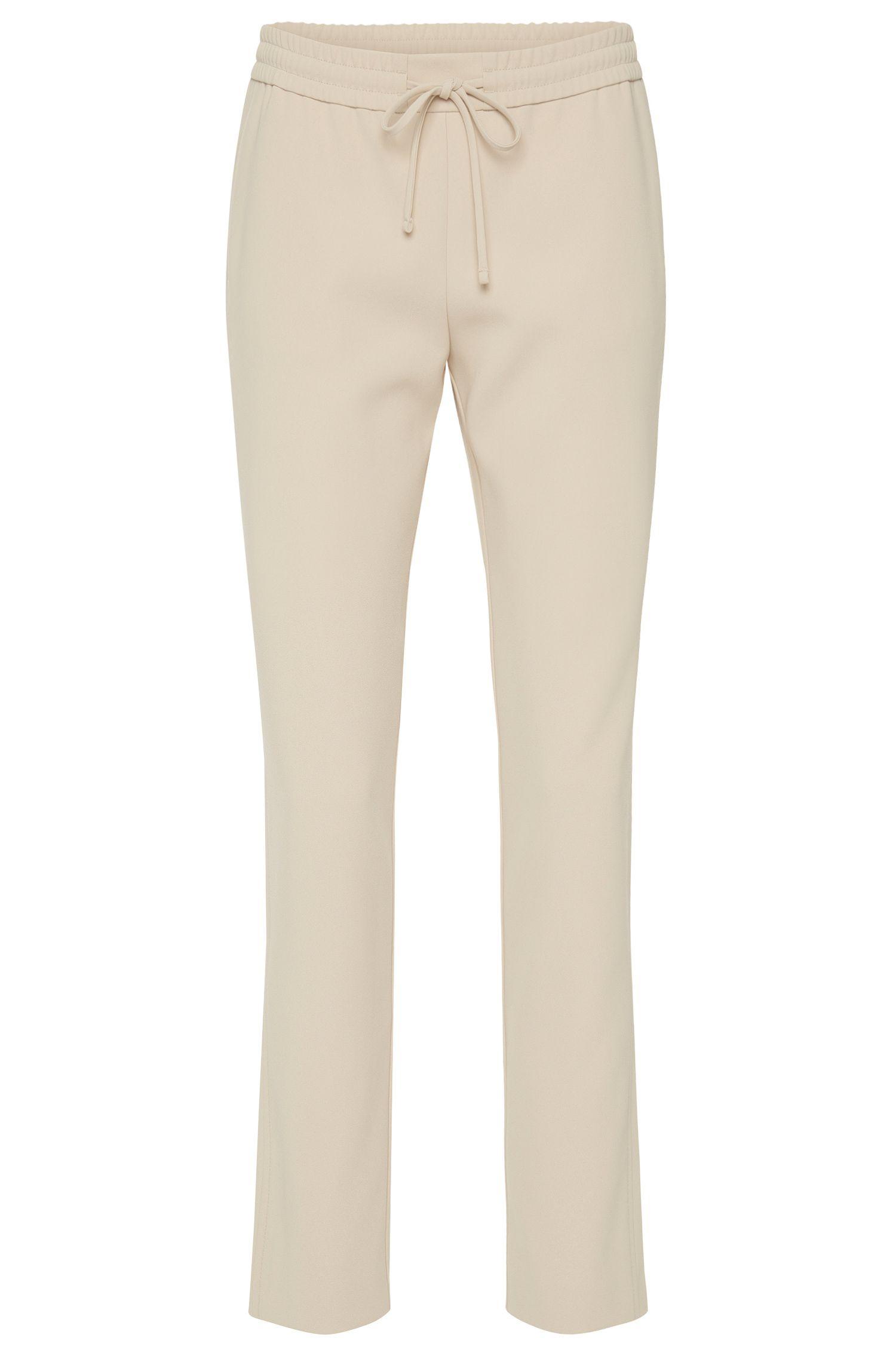 Pantaloni in tinta unita in materiali misti con vita con coulisse: 'Aryna'