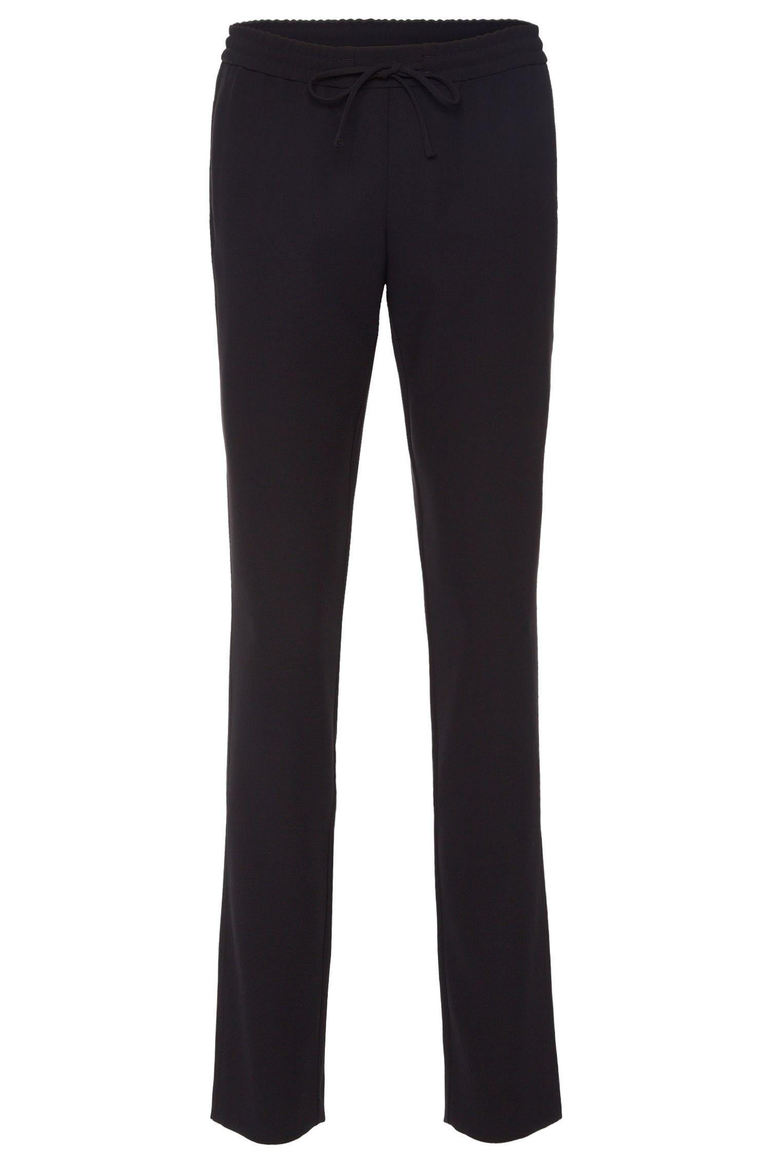 Pantalon uni en matières mélangées doté d'un cordon de serrage: «Aryna»