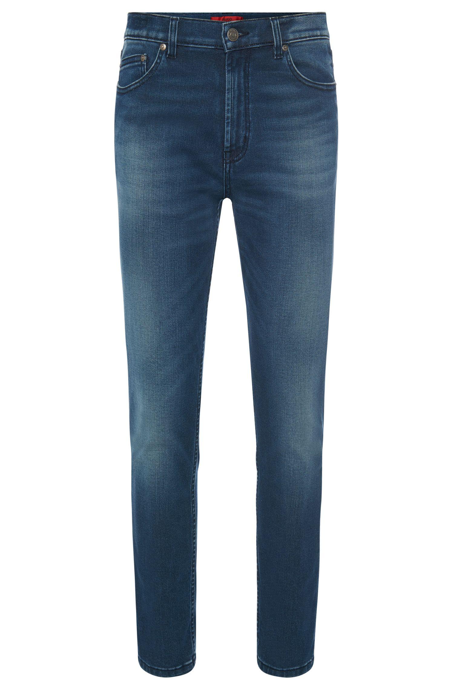 Slim-Fit Jeans aus elastischem Baumwoll-Mix mit Used-Waschung: 'HUGO 332'