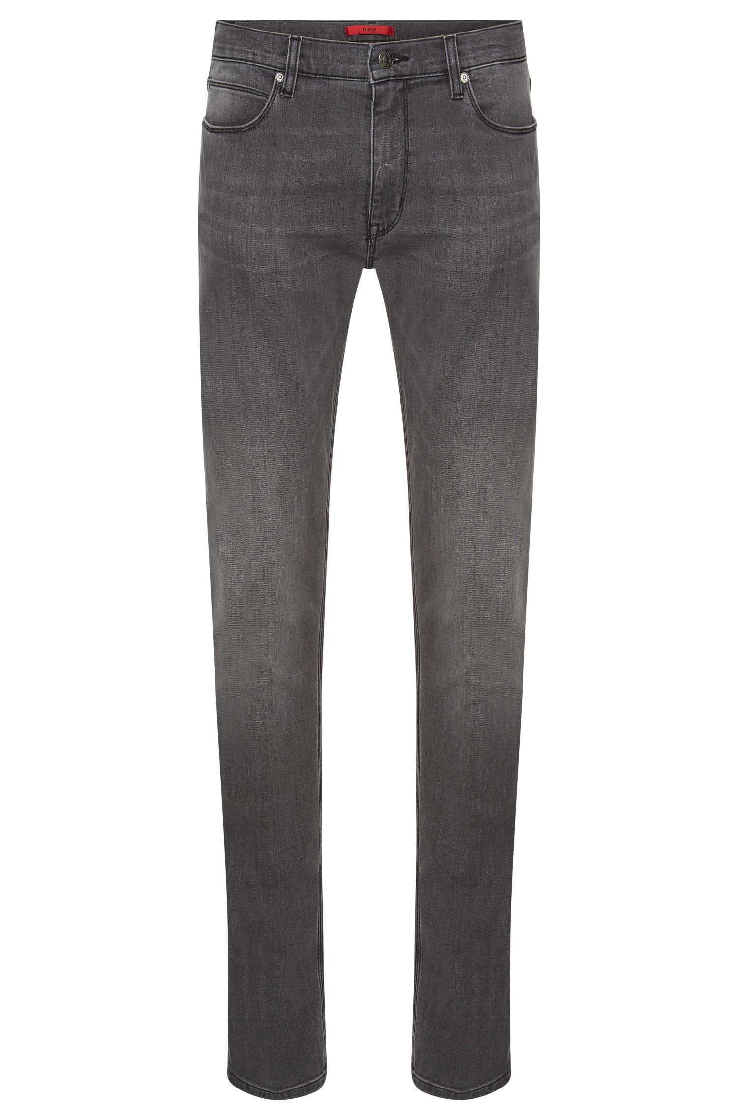 Jeans Slim Fit en coton stretch au délavage à effet usé: «HUGO708»