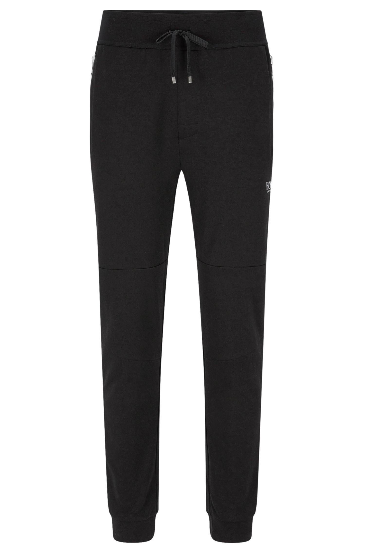 Pantalon molletonné en coton mélangé pourvu de zips de couleur contrastante: «Long Pant Cuffs»