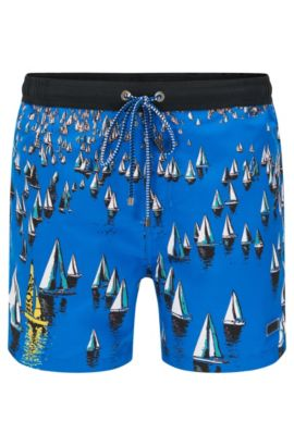 Quick-drying swim shorts in material blend with an all-over pattern: 'Mandarinfish', Open Blue