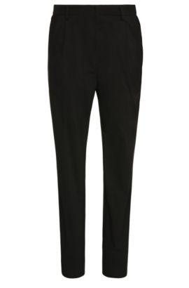 Tapered-fit trousers in cotton blend with waist pleats: 'Greyson', Black