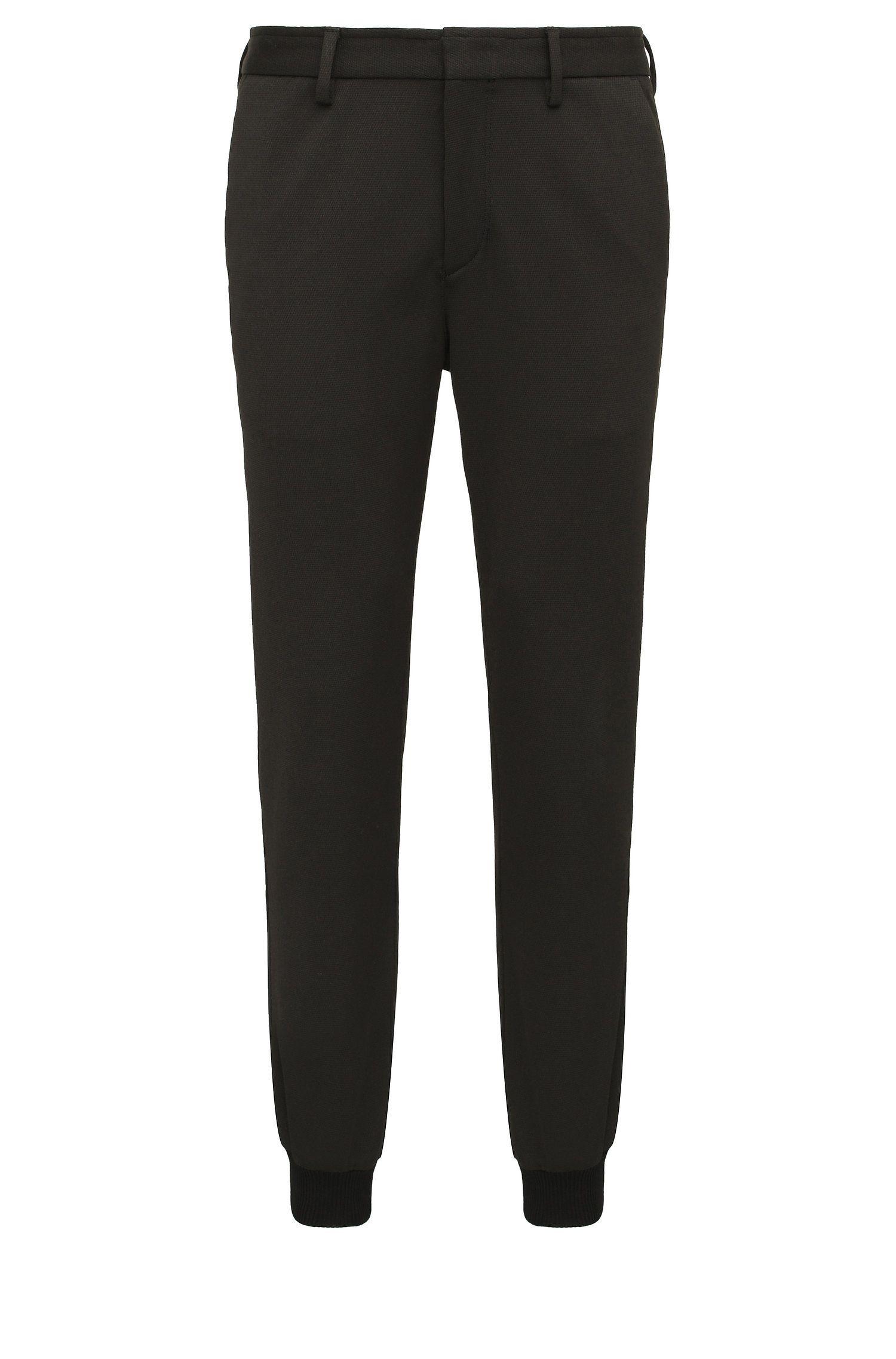 Pantalón slim fit en mezcla de materiales elásticos: 'Loomes'